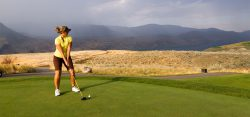 Woman golfing at Tobiano golf course.